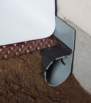 Closeup of a crawl space drainage system installed in Catlettsburg