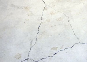 cracks in a slab floor consistent with slab heave in Olive Hill.