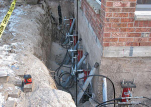 Foundation push piers installed around a house with a foundation settlement issues in Catlettsburg