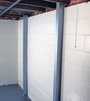 A PowerBrace™ i-beam foundation wall repair system in Saint Albans