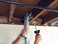 Straightening a foundation wall with the PowerBrace™ i-beam system in a Ironton home.