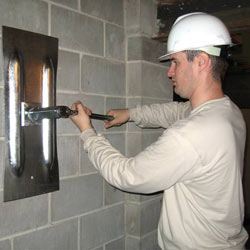 installing a wall anchor to repair an bowing foundation wall in Ironton