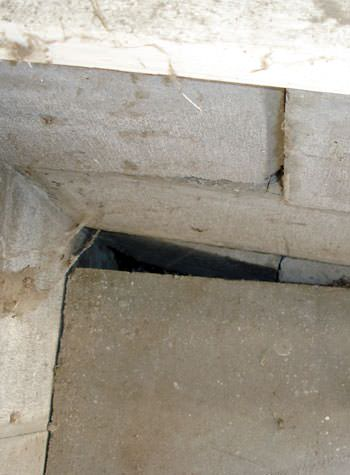 inward rotation of a foundation wall damaged by street creep in a garage in Greenup