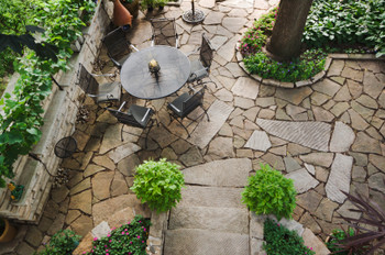Stone patios add a decorative, elegant look to any outside area